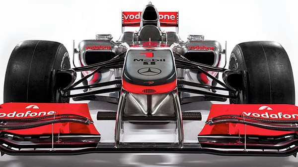 The MP4-25 front and center, featuring Jenson Button's number one atop the nose.