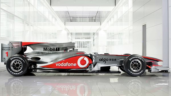 A side view of McLaren's elongated 2010 silver machine, the MP4-25.