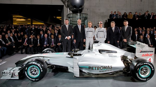 Ross Brawn, Dr. Dieter Zetsche, Nico Rosberg, Michael Schumacher, Norbert Haug and Nick Fry line-up for the cameras at the Mercedes-Benz Museum in Stuttgart.