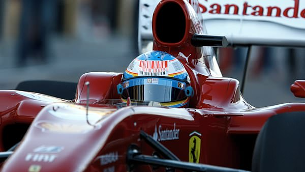 Fernando Alonso takes to the track for his first test in the red and white Ferrari F10.
