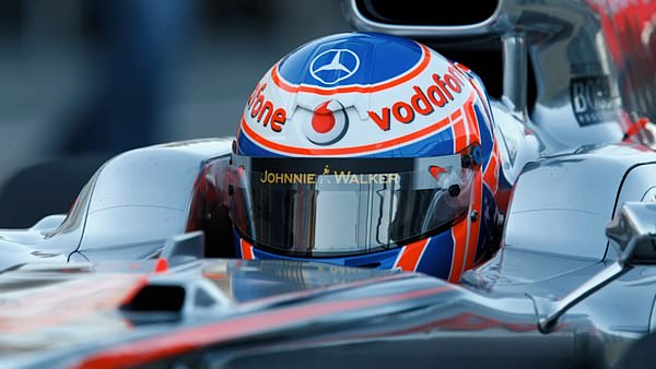Jenson Button test the McLaren MP4-25 for the first time.