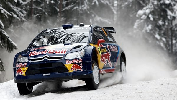 Kimi Räikkönen and Kaj Lindstroem blast through snowy Karlstad.