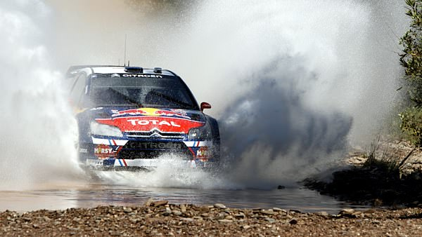 Sébastien Ogier and Julien Ingrassia make a splash and dash, during the WRC Rally Portugal, 30 May 2010.