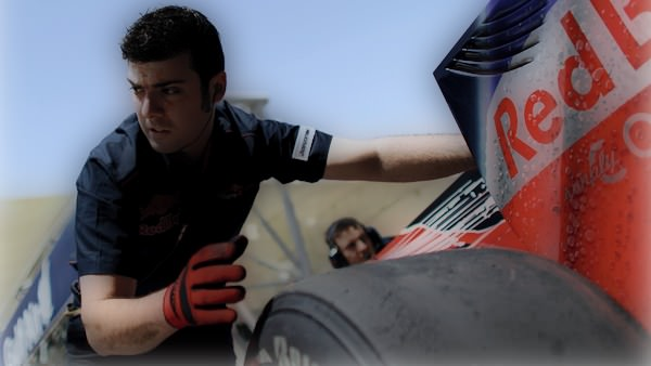 A Toro Rosso mechanic pushes the STR5 in the pitlane during the Bahrain weekend
