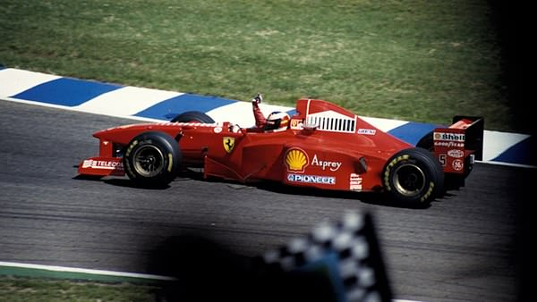 Michael Schumacher waves to his home crowd at Hockenheim, 1997.
