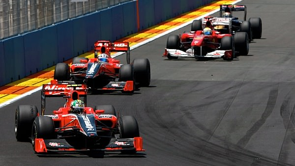 The two Virgin cars lead a train of drivers during the European Grand Prix weekend
