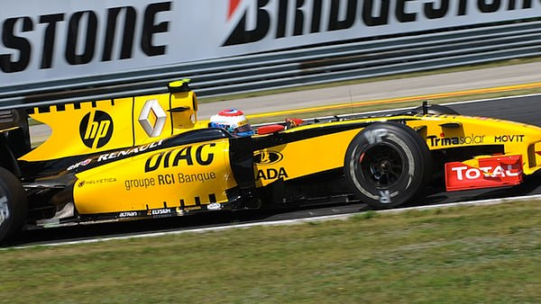 Vitaly Petrov steers the Renault round the Hungaroring, keeping ahead of Kubica