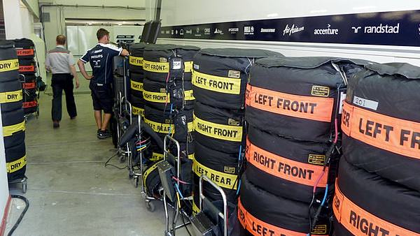 The Williams team prepare for the Grand Prix with a stack of fresh tyres