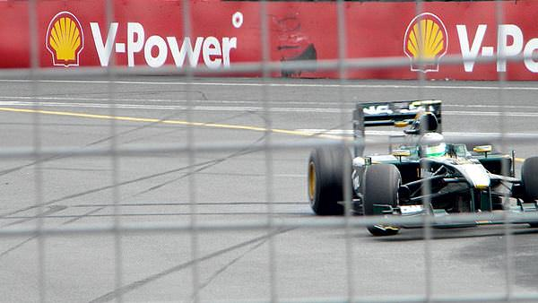 Heikki Kovalainen corrects a spin during Free Practice at the Australian Grand Prix