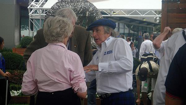 Jackie Stewart deep in conversation during Friday Free Practice