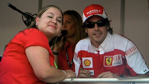 Fernando Alonso poses with Pamela during the Thursday meet and greet