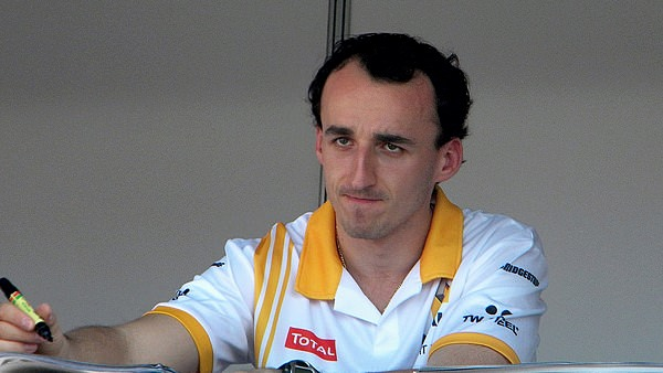 Kubica looks curious whilst signing autographs in Melbourne