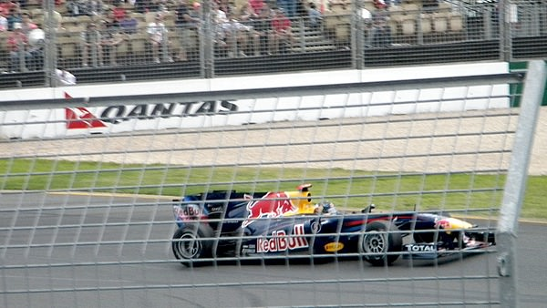 Sebastian Vettel pushes his Red Bull to pole position, beating teammate Webber