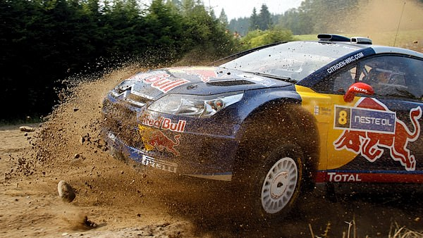 Kimi Raikkonen kicks up some dust and stones during the rally in Finland