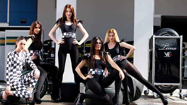 The Virgin Racing girls strike a pose to welcome LG as a team partner.