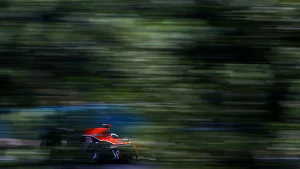 A glimpse of the Virgin Racing car through the trees at the Hungaroring