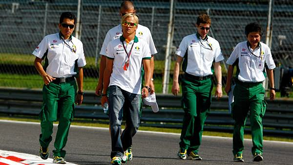 Heikki Kovalainen leads his team on a walk of the Monza track