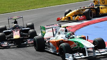 Liuzzi leads a train of cars around Monza.