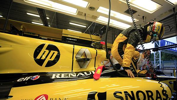 Vitaly Petrov gets settled in his Renault during the Belgian GP weekend