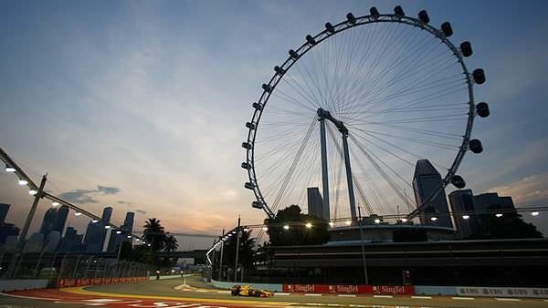 The big wheel towers over Vitaly Petrov's Renault during Friday in Singapore