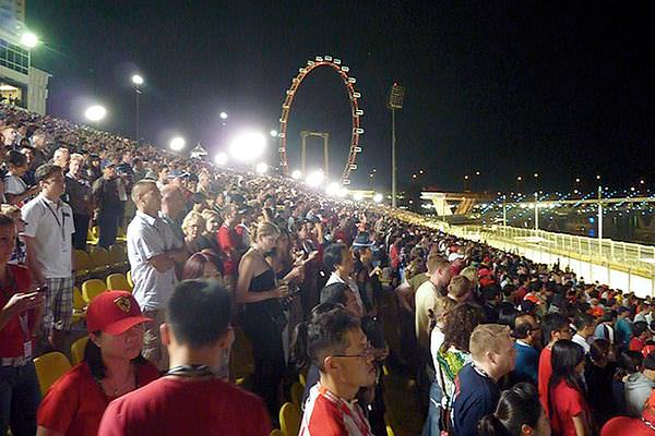 Fans gather and the big wheel lights the way as the track action begins