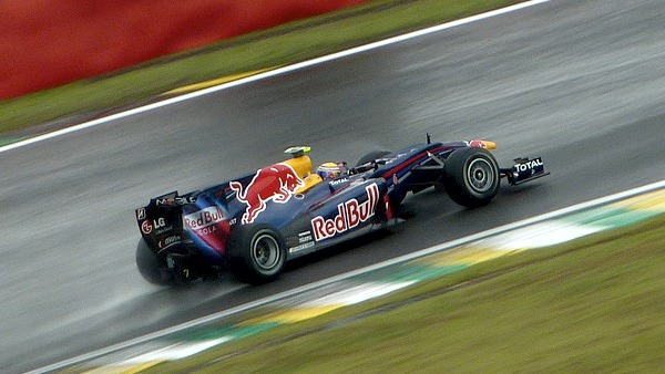 Mark Webber steers his car through the wet