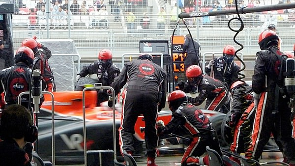 The Virgin mechanics get busy during a pit stop