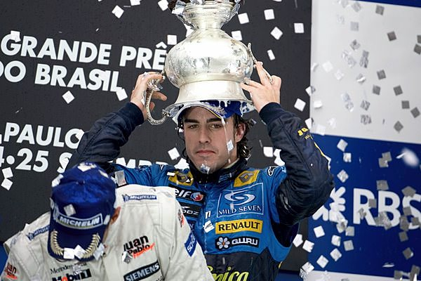 Fernando Alonso wears some unusual headgear whilst celebrating in 2005