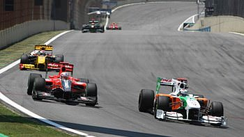 Sutil does battle with Glock into Turn 1 at Brazil