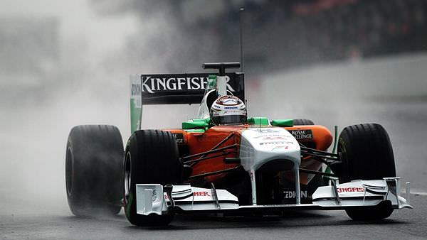 Adrian Sutil gives his Force India a run around a wet Barcelona track