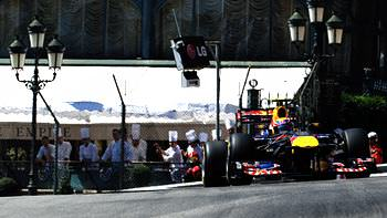 Mark Webber winds his way through the streets of Monte Carlo