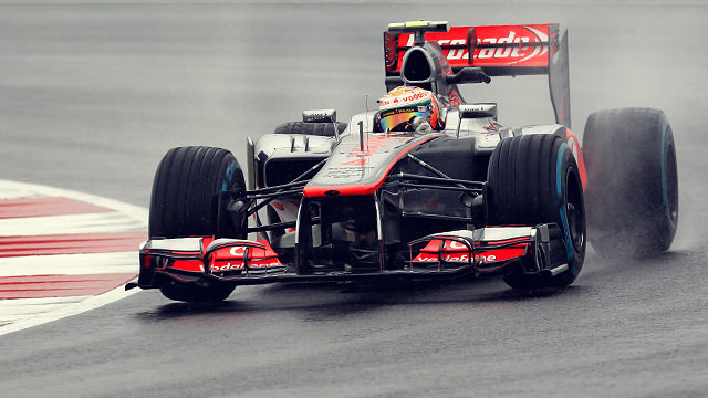 Lotus and McLaren lead exceptionally wet Silverstone practice