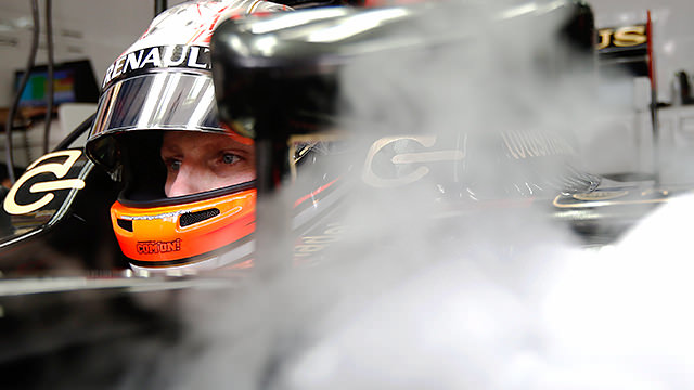 Romain Grosjean cools down in the Lotus garage