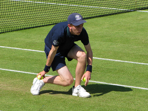 Sidepodcast F1: A ball person does their stuff during the 2010 Wimbledon tennis tournament
