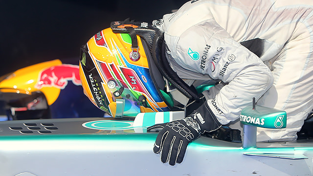 Lewis kisses race winning chassis