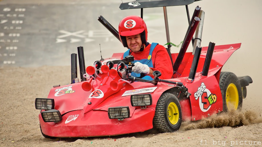 Super Seb dons red overalls and hits the soapbox derby track