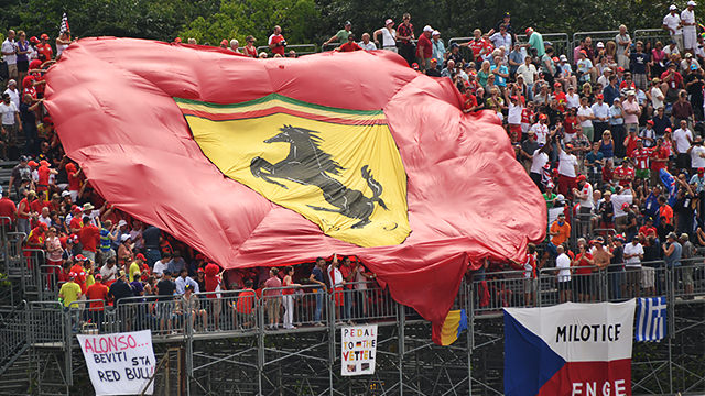 Fans cover grandstand with a Ferrari flag