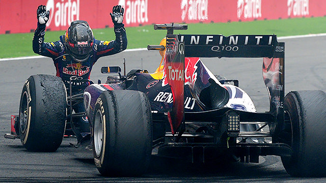 Sebastian Vettel bows down in front of his RB9 chassis