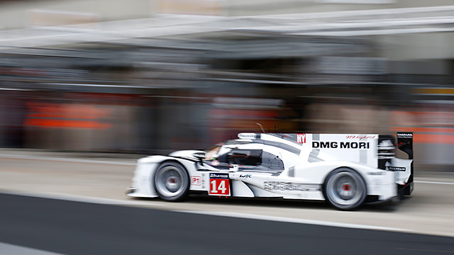 No. 14 Porsche leaves pit lane during the Le Mans test day