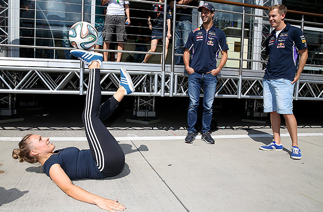 Red Bull Street Style footballer Kitti Szász performs tricks in the paddock