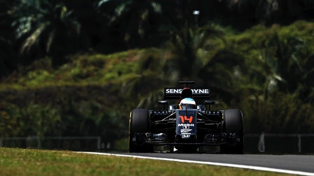 Hamilton takes pole in Sepang as Alonso settles at the back