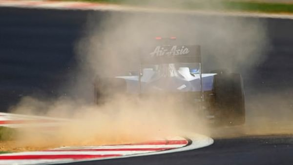 Rubens Barrichello kicks up a bit of dust as he gets to grips with the track