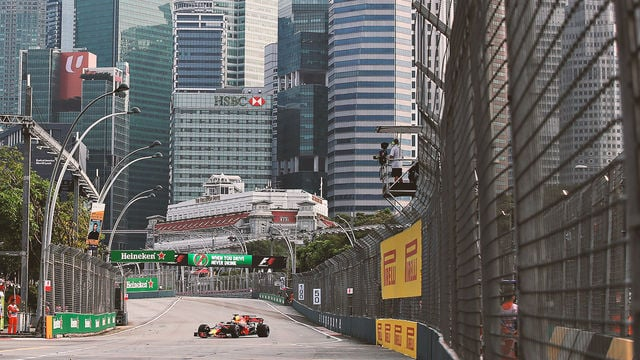 Red Bull lead the way in Singapore as slippery track catches out drivers