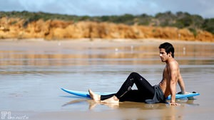 Lucas di Grassi  poses on the beach during a PR event