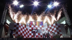 Vettel, Button and Webber celebrate their podium finish with fireworks