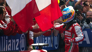 Alonso celebrates with Ferrari following a dominant victory