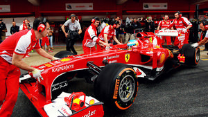 Ferrari mechanics manhandle Alonso