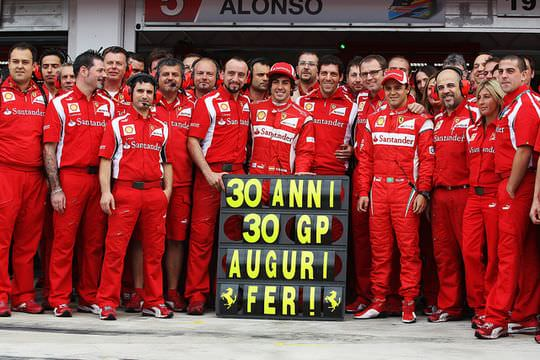 The Ferrari team celebrate Fernando Alonso's birthday