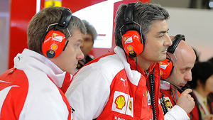 Ferrari team members in the garage in Shanghai