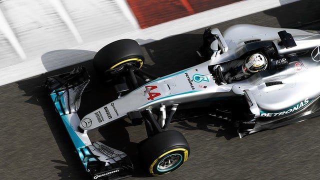 Lewis Hamilton scores pole position for title fight in Abu Dhabi